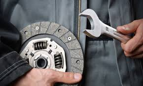 mechanic changing brake rotor
